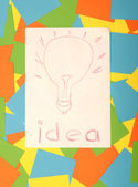 A light bulb drawn on paper symbolizing concept idea over colorf — Stock Photo