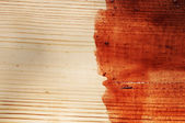 Brown paint on old wooden background — Stock Photo