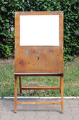 A blank painter easel over green background — Stock Photo