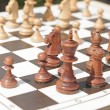 Stock Photo: Chess pieces on table in park