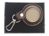 Keychain with blank metal plate in box — Stock Photo