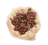 Top view of roasted coffee beans in jute bag — Stock Photo