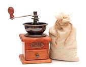 Old wooden coffee grinder, sack with coffee beans isolated on wh — Stock Photo