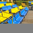 Empty plastic stadium seats in a row  — Stock Photo