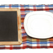 Menu blackboard lying on white background with plate, knife and — Stock Photo