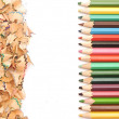 Colorful pencil border colorful pencil shavings on white backgro — Stock Photo