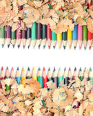 Colorful pencil with colorful pencil shavings on white backgroun — Stock Photo
