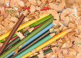 Heap of color pencil shaves isolated on white background. Back t — Stock Photo