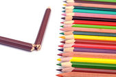 Colorful pencils and one broken — Stock Photo