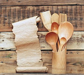 Kitchen wooden utensils in retro bucket with blank paper scroll — Stock Photo