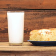 Stock Photo: Homemade pie with apples and a glass of milk
