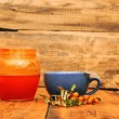 Hot drink with sea-buckthorn berries — Stock Photo