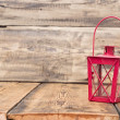 Red vintage lamp on rustic wooden table — Zdjęcie stockowe