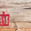 Red vintage lamp on wooden table — Stockfoto