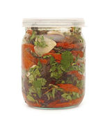 Vegetable in glass jar on a white background — 图库照片