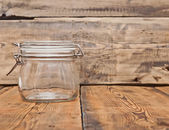 Glass jar on old wooden table — Stockfoto