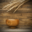 Golden wheat on the old wooden background — Stock Photo #32218567