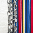Paper vintage and metal chain border colorful stripe fabric — Stock Photo #32326021