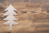 Christmas tree made of gray cardboard on wooden background — Stock Photo