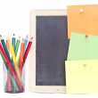 Colorful notes on a small black board with pencils on white — Stock Photo #32729059