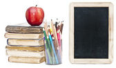 Small chalkboard with an apple, a pencils and books — Stock Photo