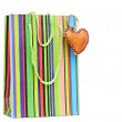 Colorful paper shopping bag with brown heart — Stock Photo
