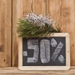 Fifty percent discount written on blackboard — Stock Photo