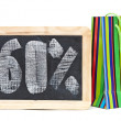 Sixty percent discount written on blackboard with colorful bag — Stock Photo