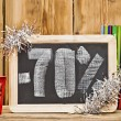 Seventy percent discount written on blackboard — Stock Photo