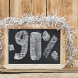 Ninety percent discount written on blackboard — Stock Photo