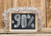 Ninety percent discount written on blackboard — Stock Photo