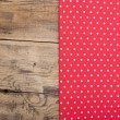Empty wooden deck table with red tablecloth with polka dots — Stock Photo