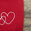 Two embroidered heart on brown background — Stock Photo