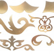 Golden collection of carved decorative elements — Stock Photo