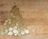 Christmas tree made from golden drops elements on wood backgroun — Stockfoto