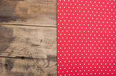 Empty wooden deck table with red tablecloth with polka dots — Stockfoto