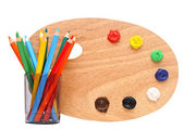 Wooden artists palette loaded with various colour paints and col — Foto de Stock