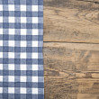 Tablecloth textile texture on wooden table background — Stockfoto