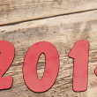 Text 2014 on wood background — Stock Photo