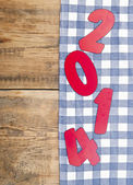 2014 new year on checkered textile background — Stock Photo
