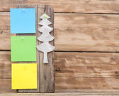 Colorful reminder notes attached on a old wooden signboard with — Stockfoto
