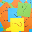 Pile of colorful sticky notes with question marks symbolizing id — Stock Photo