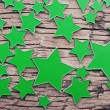 Stars on a old wooden background — Stock Photo