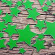 Stars on a old wooden background — Stock Photo #34844617