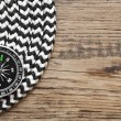 Marine roll ropes and compass on wooden background — Stock Photo