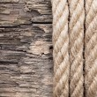 Very old wooden background with rope — Stock Photo