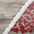 Stars and marine rope on a old wooden background — Foto de Stock