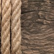 Very old wooden background with rope — Stock Photo #34845829