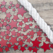 Stars and marine rope on a old wooden background — Stock Photo