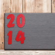 Number 2014 on wooden plate with copy space for your text. — Stock Photo